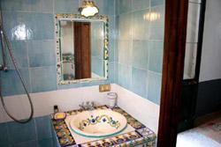Sorrento Suite: Bathroom with ancient Majolica tiles of Suite Alimuri in Sorrento